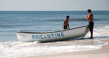 Brigantine patrol boat at the ocean's edge