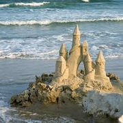 sandcastle on waters edge