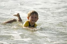 Child swimming in the ocean